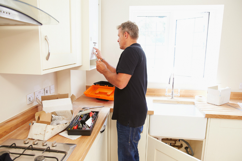 Mature man fitting a kitchen