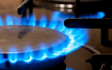 Black gas stove and two burning flames close-up