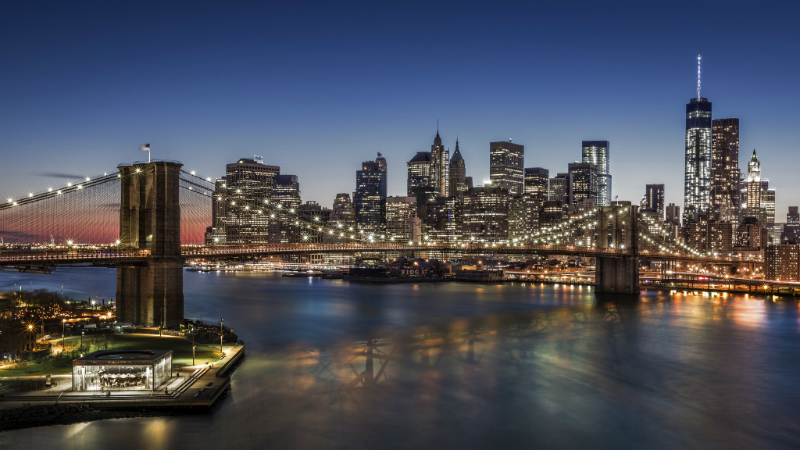 A night time view of Brooklyn Bridge and Downton Manhattan