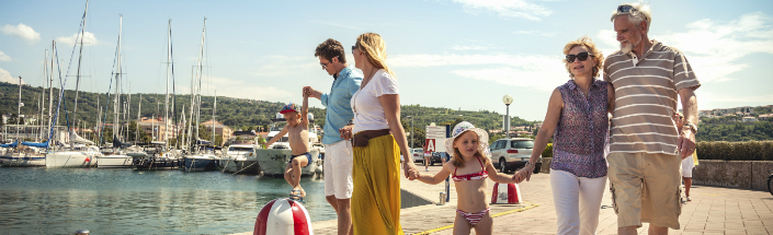 Family walking together in a marina