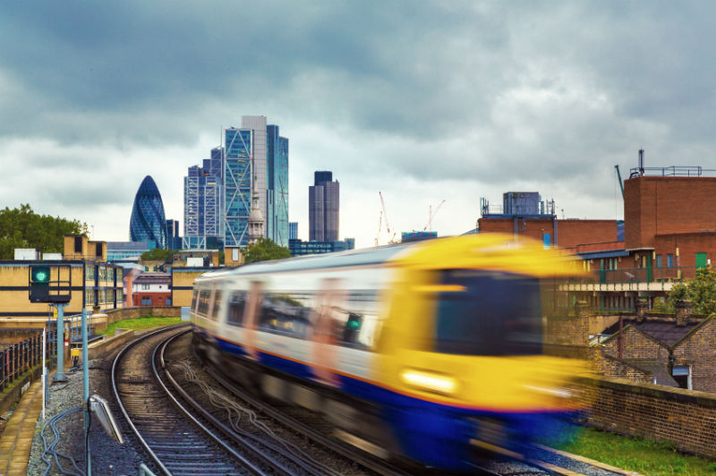 London Overground with skyscrapers.