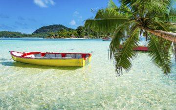 Boat docked near a beach in The Seychelles