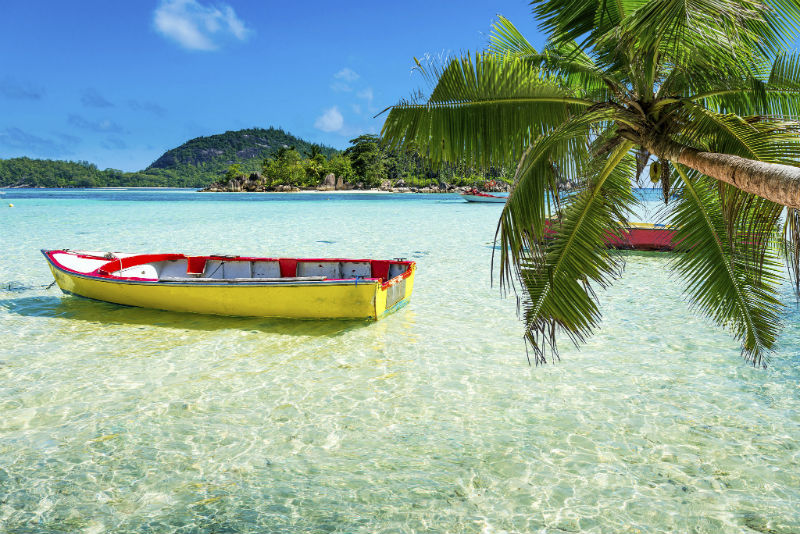 Boat docked near a beach in The Seychelles
