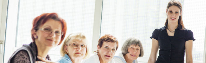 Mature women around a table