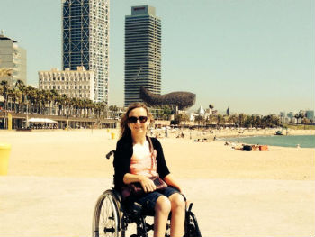 Tourism for All's Information Manager Carrie-Ann Lightley on a beach