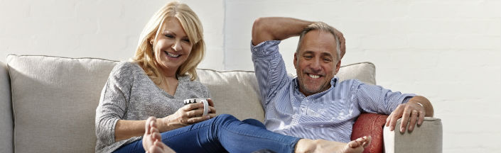 Couple laughing on a Couch