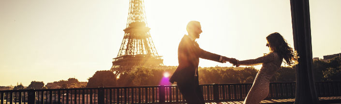 Couple spinning around in front of Eiffel Tower