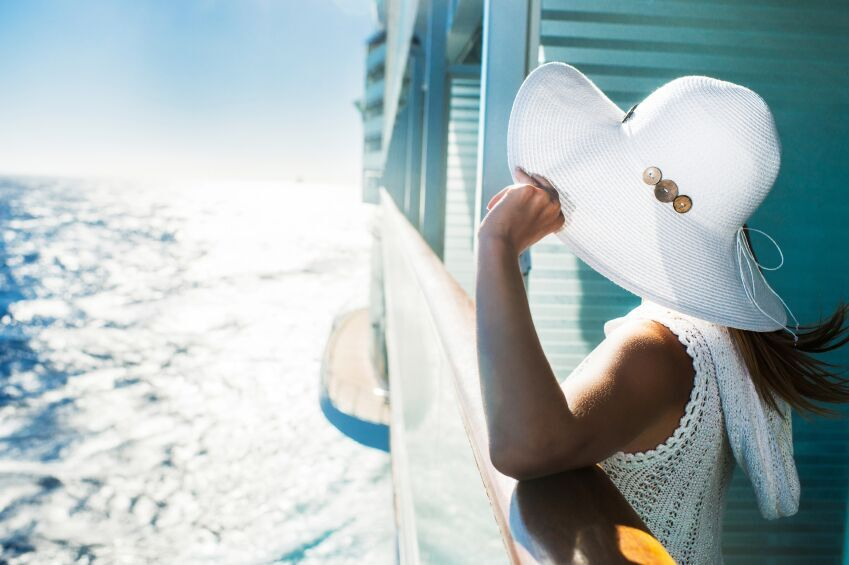 Woman on a Cruise ship looking out to sea