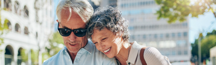 Mature couple looking at a city map