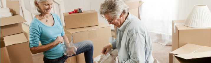 Mature couple pack their home