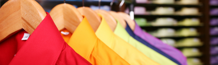 Colourful shirts on a rail