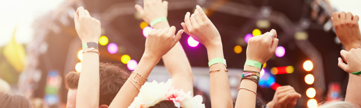 Hands raised in the air at a music festival