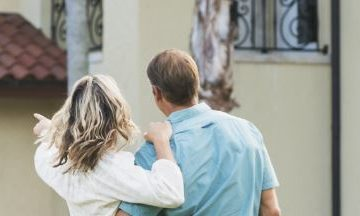 Couple looking at buying a holiday home