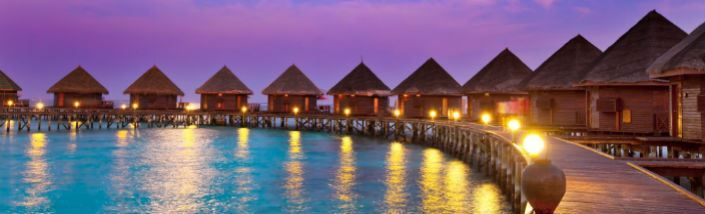Luxury huts perched on stilts above the Indian Ocean in the Maldives.