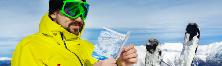 Man looking at piste map