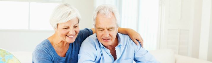 Mature couple looking at retirement spots