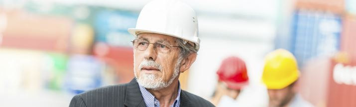 Mature Man Working on a Building Site