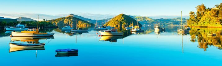 The beautiful glass-like waters of Port Chalmers Dunedin New Zealand