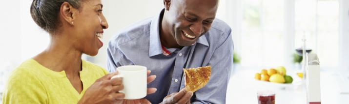 Mature couple enjoying breakfast together