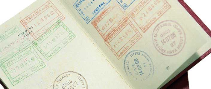 Passport with lots of stamps in
