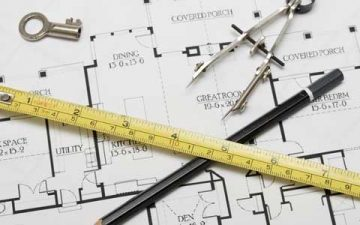 Planning a home extension - drawing tools on a house blueprint