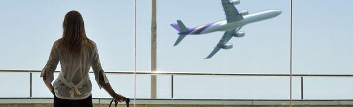 Woman watching Aeroplane take off