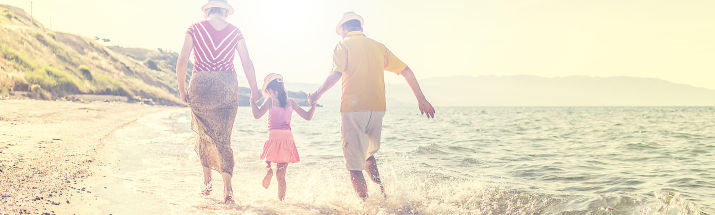 Couple and child on beach