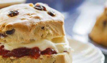 Close up of scones with cream and jam,