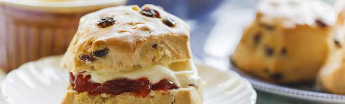Close up of scones with cream and jam,
