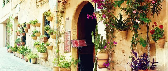 Traditional spanish street decorated by flowerpots