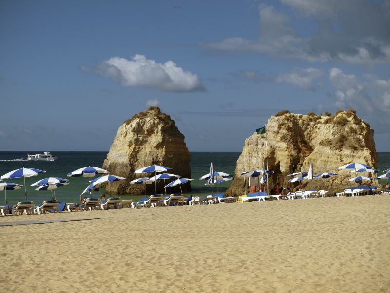 Parasols on the sandy Gale Beach, Portugal