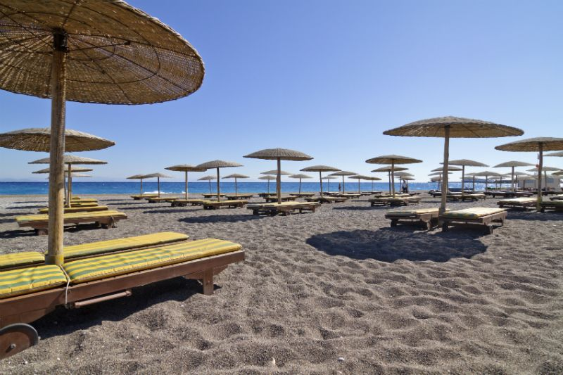 Sun loungers and beach umbrellas in Rhodes