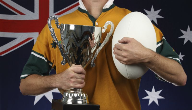 Australian Rugby Union Team Player with Ball and Trophy
