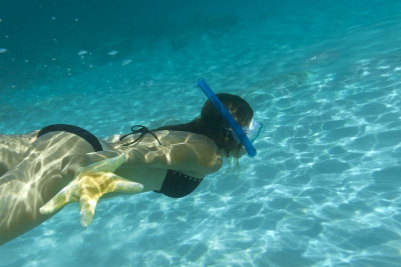 Woman snorkeling in the Mediterranean Sea, Spain