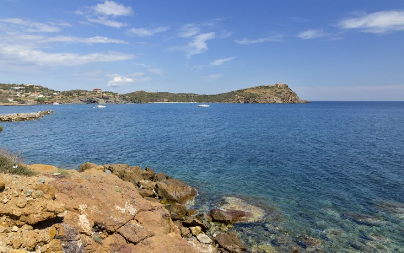 A calm sea view of Cape Sounion, Greece