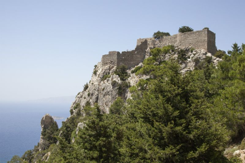 The leafy Monolithos Castle at the top of a mountain, Rhodes, Greece