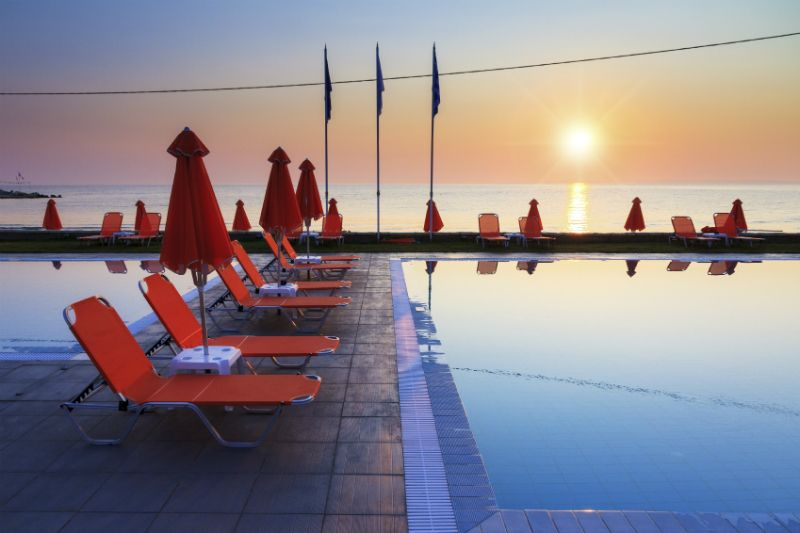 Pools, sun loungers and umbrellas at a Hotel Pool, Zante, Greece