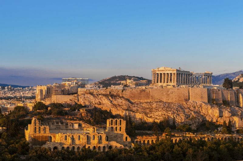 The Acropolis of Athens on a hilltop at sunset, Greece