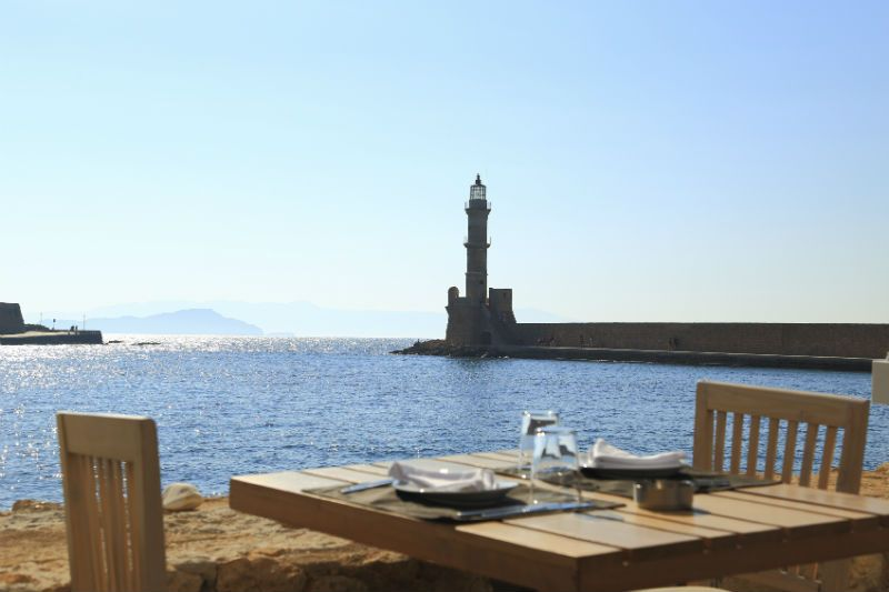 Restaurant table overlooking Chania harbour