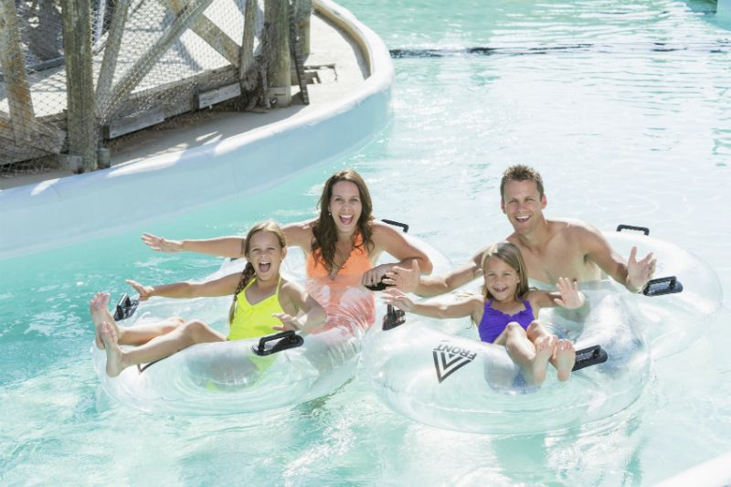 Family on Lazy River at water park.