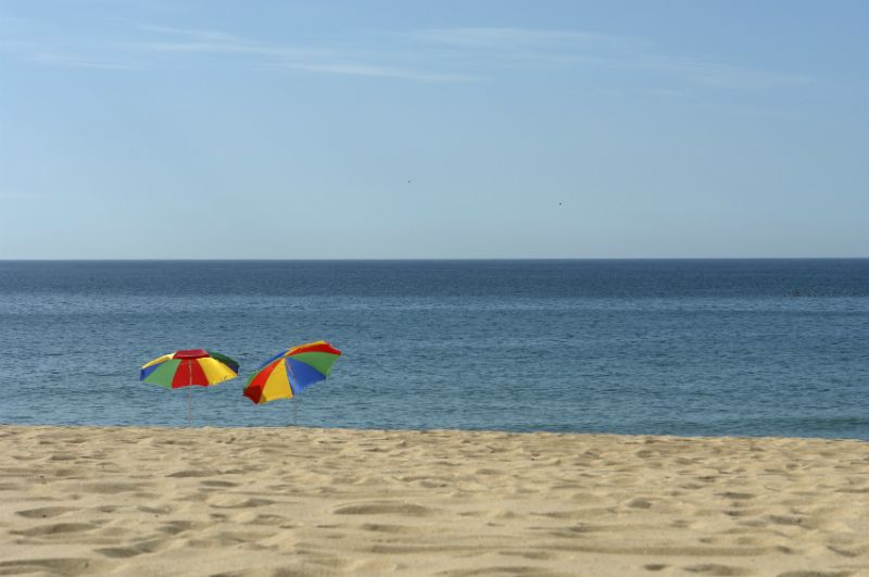 Colourful umbrellas on the Meia Praia Beach, Algarve, Portugal