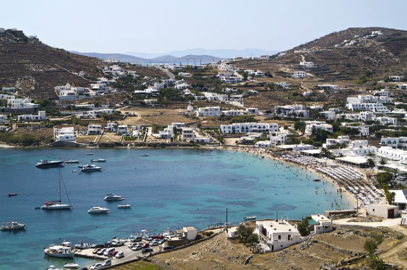 Boats and villas surrounding Ornos Beach, Mykonos, Greece