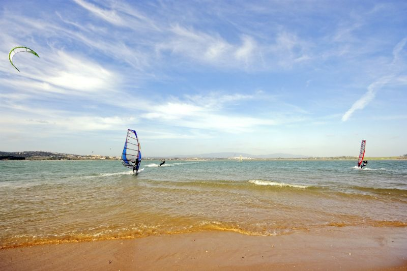 Windsurfing or Kitesurfing on a beach in Portugal