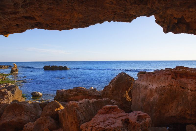 Looking out of the cave at La Cova Talla, Denia, Spain