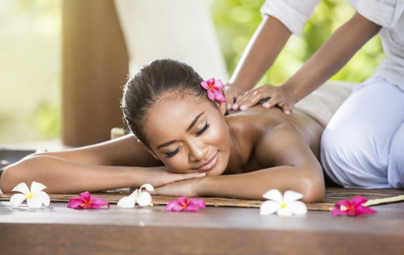 A typical Balinese body massage with flowers and oils, Indonesia
