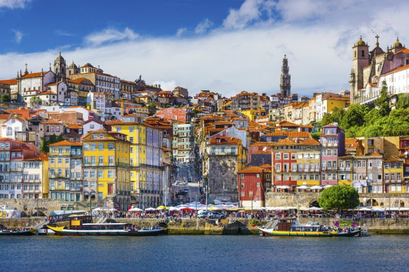 Colourful buildings lining the river in Porto, Portugal