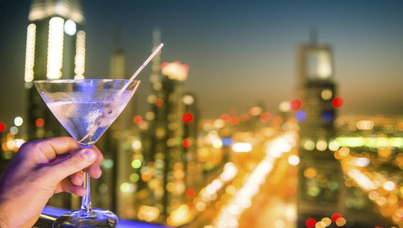 Cocktail with Dubai City Lights in Background