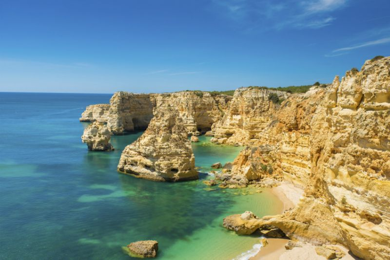 Clear waters, coves and rocks at Parai da Marinha, Portugal
