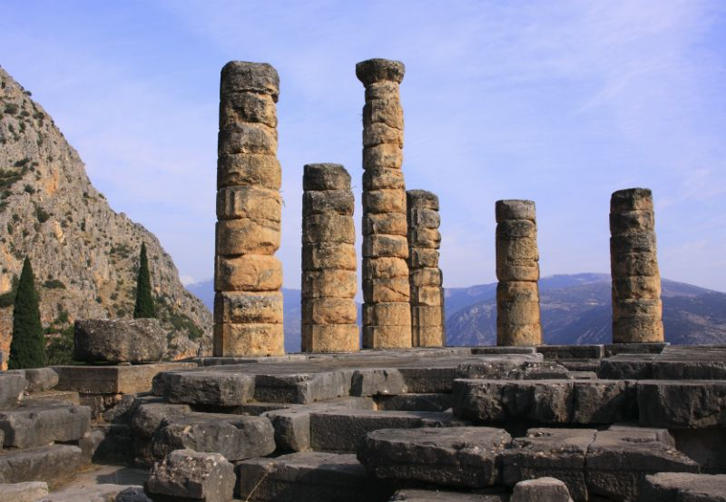 Ruins at The Temple of Apollo in Delphi overlooking mountains, Greece