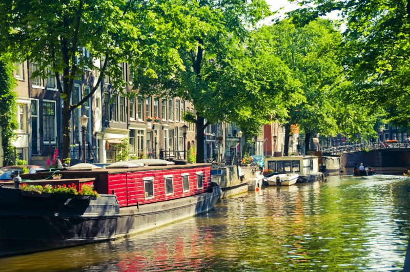 Cobble stoned Canals and Canalboats in Amsterdam, The Netherlands